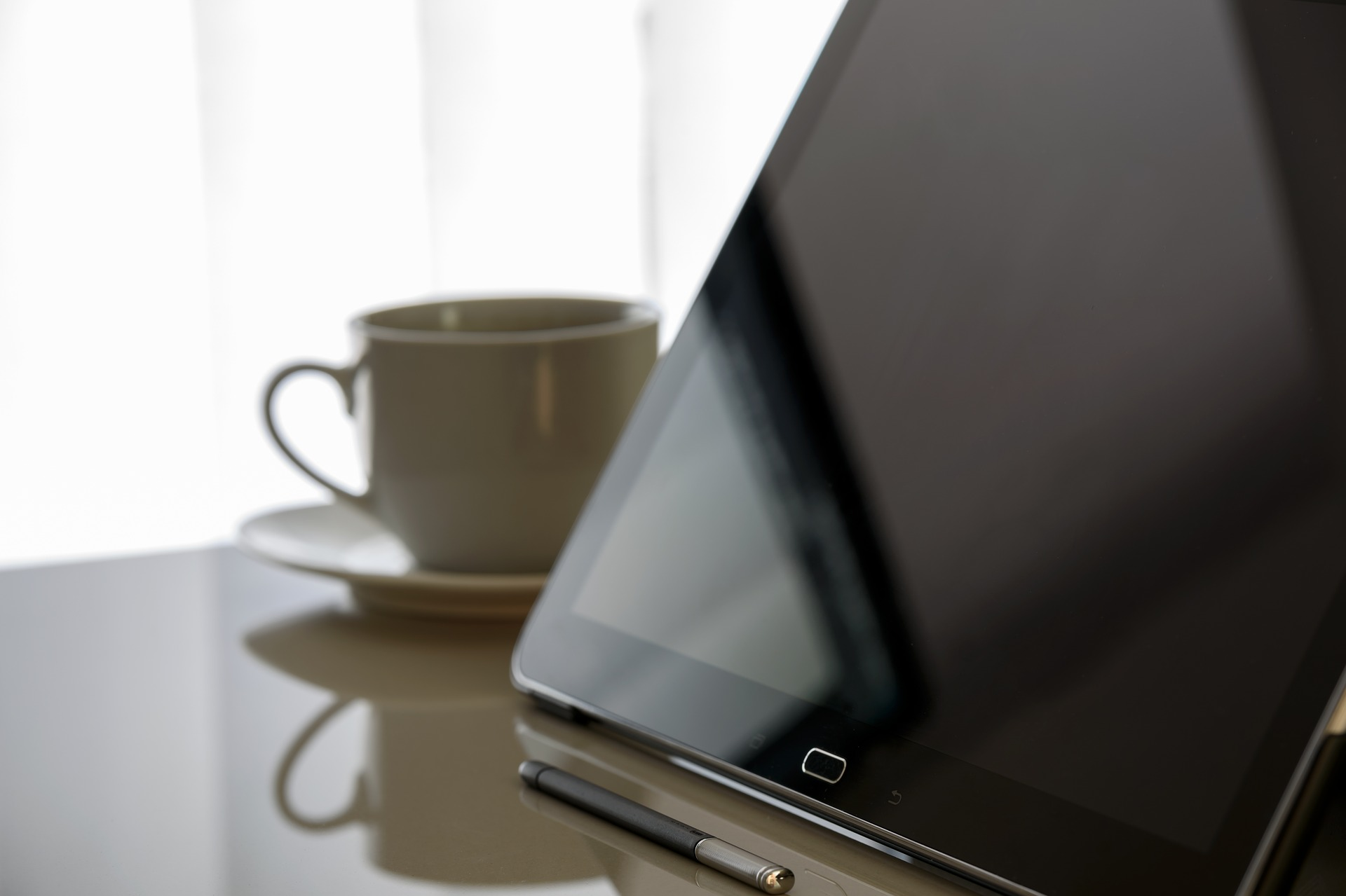 Image used for News link showing a tablet computer on desk next to a coffee cup - ready to read the news