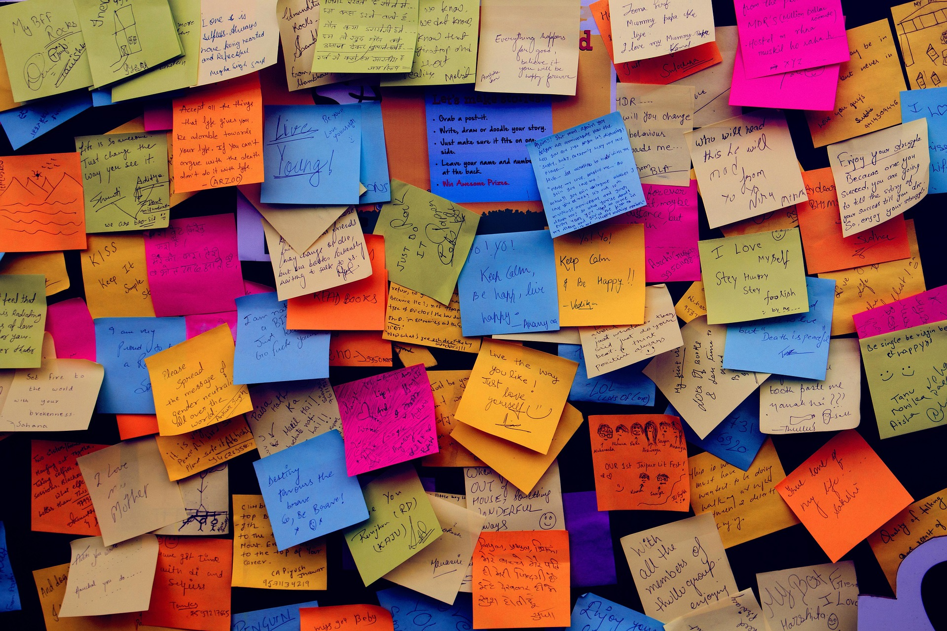 Wall of colorful sticky notes with different people messages - used for link picture time to talk section